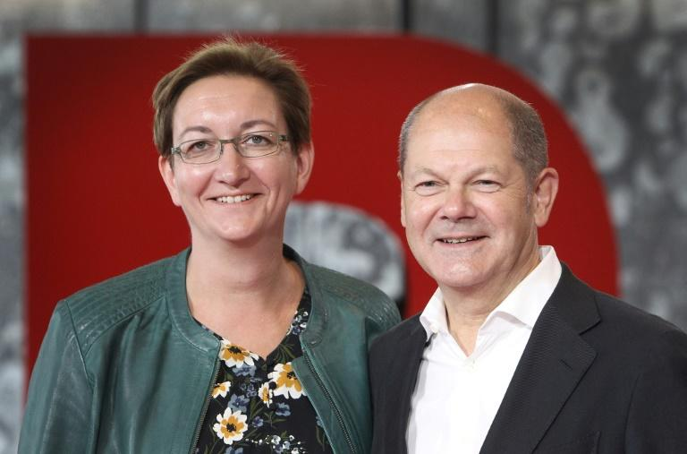 Klara Geywitz (L) and Olaf Scholz are tipped to lead Germany's Social Democratic Party SPD, in which case it would likely remain a coalition partner with Angela Merkel's CDU