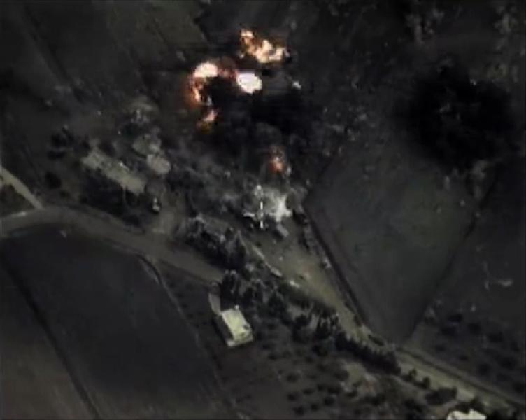 """A video grab made on September 30, 2015 shows an image made available on the Russian Defence Ministry's official website, purporting to show an airstrike in Syria"""" (AFP Photo/)"""