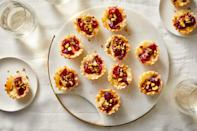 """<p><strong>Recipe: <a href=""""https://www.southernliving.com/recipes/cranberry-brie-bites"""" rel=""""nofollow noopener"""" target=""""_blank"""" data-ylk=""""slk:Cranberry Brie Bites"""" class=""""link rapid-noclick-resp"""">Cranberry Brie Bites</a></strong></p> <p>The combination of salty brie with fruity cranberry is a winning duo in this four-ingredient appetizer. </p>"""