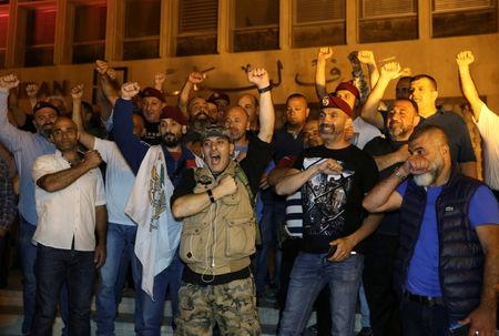 FILE PHOTO: Retired soldiers gesture as they take part in a protest over proposed cuts to the cost of military pensions and benefits in front of the central bank in Beirut, Lebanon May 12, 2019. REUTERS/Mohamed Azakir//File Photo
