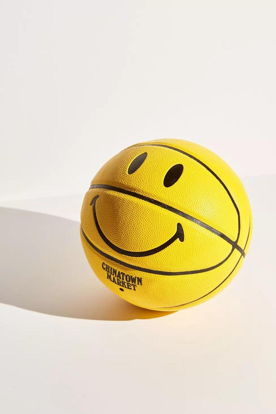 <p>You can't help but be happy when you look at this <span>Chinatown Market X Smiley UO Exclusive Smiley Basketball</span> ($59).</p>