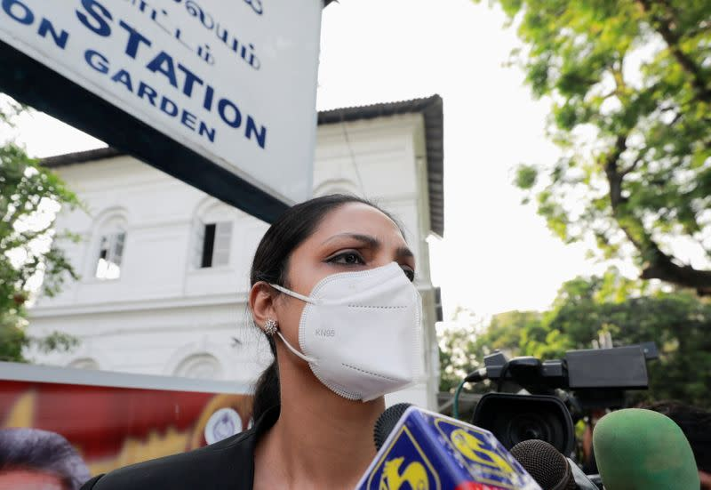 Reigning Mrs World Caroline Jurie leaves the police station in Colombo