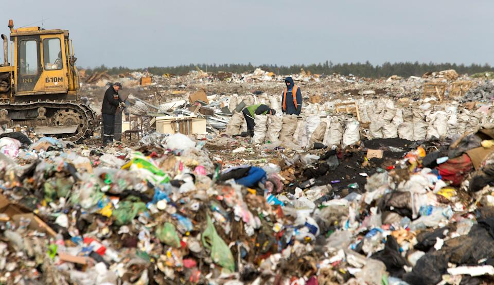 Workers sort waste at the Ecores waste processing enterprise on the outskirts of Minsk, March 12, 2015. (Photo: Vasily Fedosenko / Reuters)