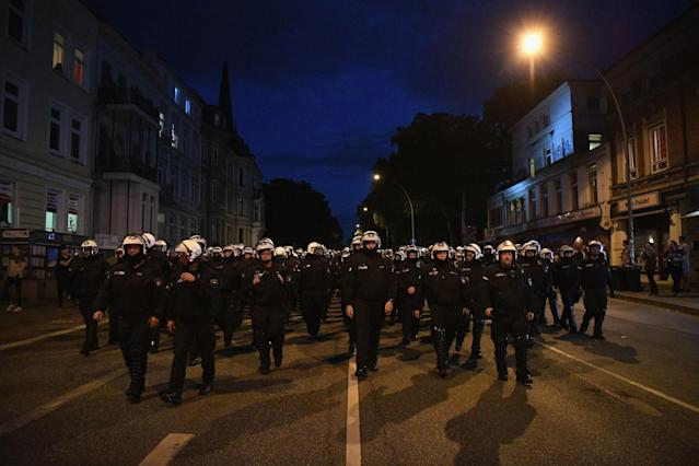 "<p>Riot police walk down a road during the ""Welcome to Hell"" protest march on July 6, 2017 in Hamburg, Germany. Leaders of the G20 group of nations are arriving in Hamburg today for the July 7-8 economic summit and authorities are bracing for large-scale and disruptive protest efforts tonight at the ""Welcome to Hell"" anti-G20 protest. (Photo: Leon Neal/Getty Images) </p>"