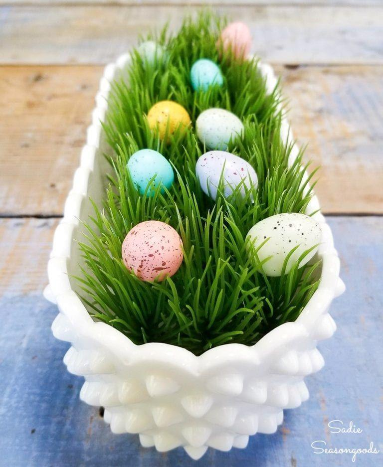 """<p>For as little upkeep as possible, fill flower boxes with artificial grass and plastic Easter eggs. When Easter is over, swap the eggs for faux flowers. </p><p><em><a href=""""https://www.sadieseasongoods.com/easter-decor-hobnail-milk-glass/"""" rel=""""nofollow noopener"""" target=""""_blank"""" data-ylk=""""slk:Get the tutorial at Sadie's Seasongoods »"""" class=""""link rapid-noclick-resp"""">Get the tutorial at Sadie's Seasongoods »</a></em></p><p><strong>RELATED:</strong> <a href=""""https://www.goodhousekeeping.com/holidays/easter-ideas/g2217/easter-decorations/"""" rel=""""nofollow noopener"""" target=""""_blank"""" data-ylk=""""slk:Cute Ways to Decorate This Easter"""" class=""""link rapid-noclick-resp"""">Cute Ways to Decorate This Easter</a></p>"""