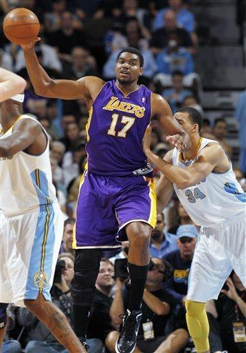 Los Angeles Lakers center Andrew Bynum, left, fileds a loose ball as Denver Nuggets center JaVale McGee covers in the third quarter of Game 3 of the Nuggets' 99-84 victory in the teams' first-round NBA playoff series in Denver on Friday, May 4, 2012. (AP Photo/David Zalubowski)