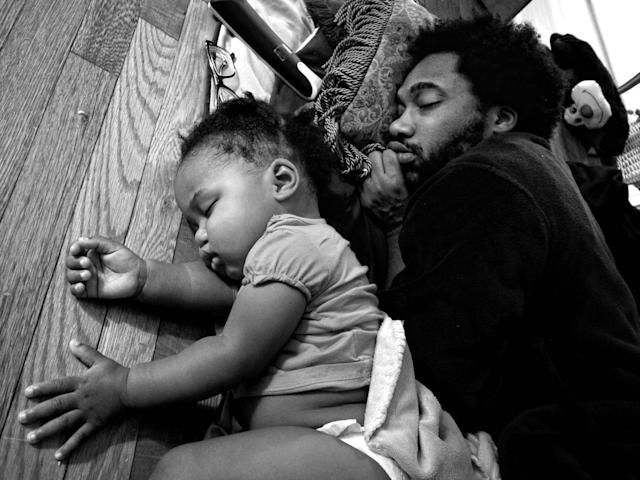 <p>Anthony Francis falls asleep in front of his TV with daughter Tena, Camp Lejeune, N.C., 2012. (Photograph © Zun Lee) </p>
