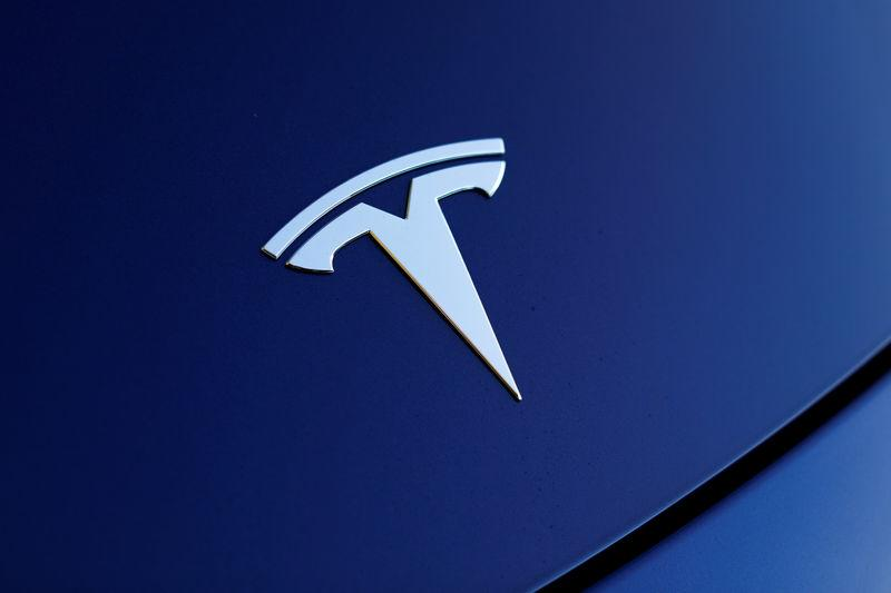 The front hood logo on a 2018 Tesla Model 3 electric vehicle is shown in this photo illustration taken in Cardiff, California, U.S., June 1, 2018. REUTERS/Mike Blake