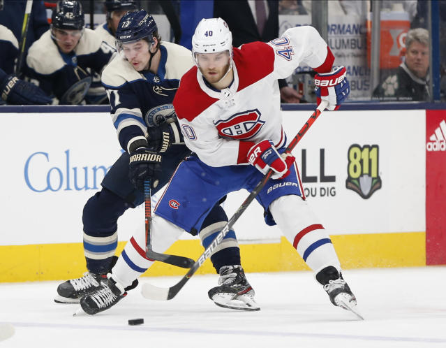Columbus Blue Jackets' Josh Anderson, left, tries to steal the puck from Montreal Canadiens' Joel Armia, of Finland, during the third period of an NHL hockey game Tuesday, Nov. 19, 2019, in Columbus, Ohio. The Blue Jackets beat the Canadiens 5-2. (AP Photo/Jay LaPrete)