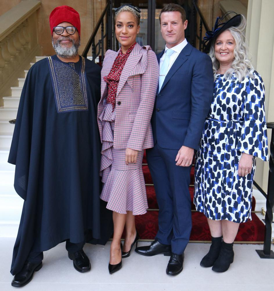 Cush Jumbo in October 2019, with parents Marx and Angela, and husband Sean Griffin, receiving an OBE for her services to drama