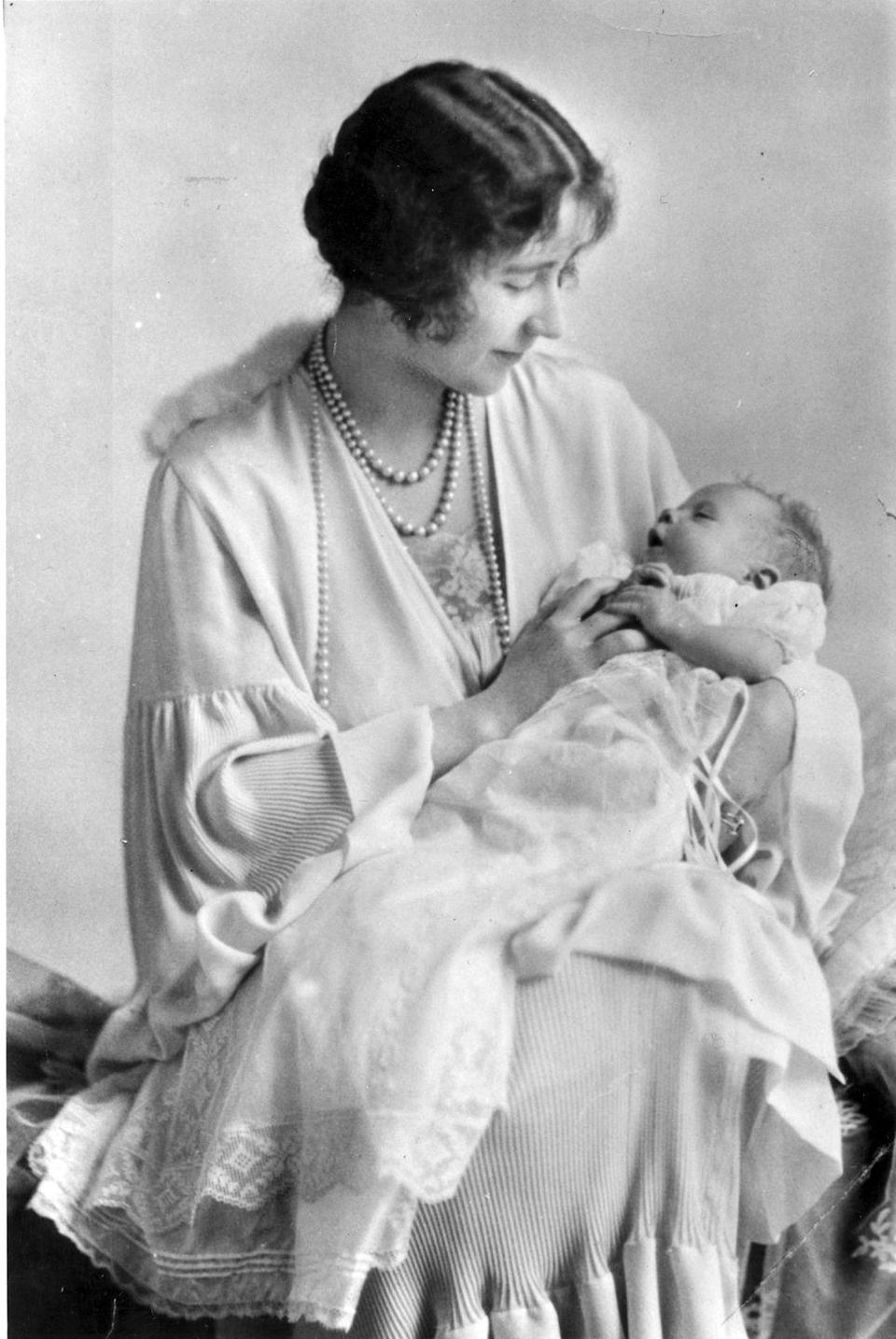 """<p>The future queen was <a href=""""http://royalcentral.co.uk/blogs/the-queens-london-birthplace-17-bruton-st-59298"""" rel=""""nofollow noopener"""" target=""""_blank"""" data-ylk=""""slk:born at 2:40 a.m."""" class=""""link rapid-noclick-resp"""">born at 2:40 a.m.</a> on April 21, 1926, at <a href=""""https://www.royalcollection.org.uk/collection/2002127/no-17-bruton-street-london-w1-the-birthplace-of-hm-queen-elizabeth-ii"""" rel=""""nofollow noopener"""" target=""""_blank"""" data-ylk=""""slk:17 Bruton Street in Mayfair"""" class=""""link rapid-noclick-resp"""">17 Bruton Street in Mayfair</a>, the London home of her maternal grandparents, the Earl and Countess of Strathmore. </p><p><em>Left</em>: Elizabeth, Duchess of York (1900-2002) holds her baby, the future Queen Elizabeth II, in May 1926.</p><p><strong>More</strong>: <a href=""""https://www.townandcountrymag.com/society/g9234793/queen-elizabeth-facts/"""" rel=""""nofollow noopener"""" target=""""_blank"""" data-ylk=""""slk:Fascinating Facts About Queen Elizabeth II's Life"""" class=""""link rapid-noclick-resp"""">Fascinating Facts About Queen Elizabeth II's Life</a><br></p>"""