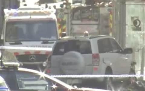 """Fourteen people have been injured, several of them critically, after acar ploughed into a crowd in central Melbournein what police described as a """"deliberate act"""". In a terrifying incident during the pre-Christmas shopping rush, the white SUV rammed into alarge number of pedestrians at high speed on thepavement outside Flinders Street railway station, one of the Australian city's main transport hubs. Police said the driver and another man havebeen arrested after what they believed """"was a deliberate act"""". Asked if the incident was terrorism-related, Victorian Police commander Russell Barrett said:""""The motivations are unknown."""" Witnesses described """"people flying everywhere""""as the vehicle, which was travelling at a reported 60mph, """"just mowed everybody down""""at around 5pm local time (6am GMT) on Thursday. Others reported that thewhite Suzuki SUV, which is said to have had two men inside, appeared not to slow down before it crashed into a tram stop bollard. The scene in Flinders Street, Melbourne, after the SUV rammed into pedestrians Credit: Twitter/sirVIX_a_lot Images from the scene showed casualties being treated in the street by paramedics. A young man in jeans and a T-shirt could be seen being arrested by three police officers on the steps of the station, although it was unclear if he had been in the car. Two men were arrested after the white SUV hit a number of pedestrians Credit: Australian Broadcast Corp/AP Emergency medical workers treat people injured in the Melbourne crash Credit: Australian Broadcasting Corp/AP After the driver of the SUV was arrested, police held a second man. He is believed to have been arrested outside Flinders Street station Credit: Andrew Lund/PA Media reports suggested a total of 19people had been injured. Police said 14 people had been taken to hospital for treatment, including several who were described as being critically ill. They included a pre-school aged child with head injuries who was taken to hospital in a serious condition. T"""