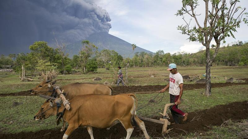 Mount Agung volcano is spewing volcanic ash, sparking warnings and disrupting flights.