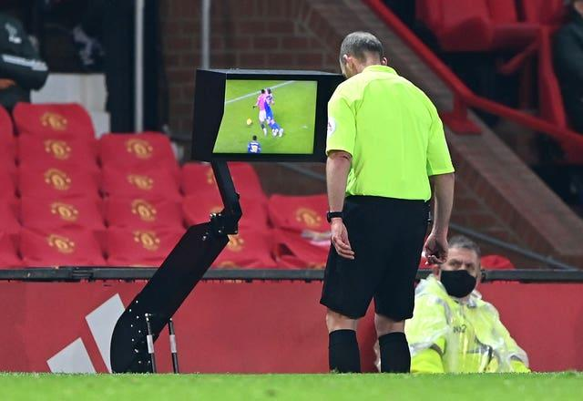 Mike Dean sent off Southampton's Jan Bednarek after consulting the VAR pitchside monitor.