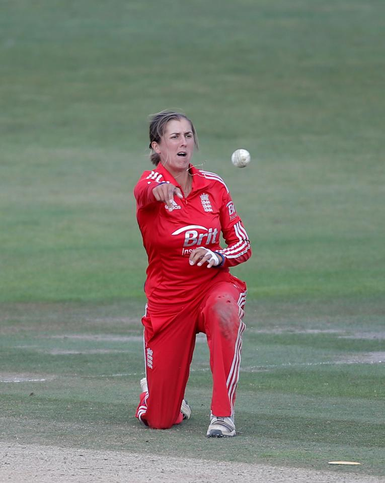 HOVE, ENGLAND - AUGUST 25:  Jenny Gunn of England fields the ball during the third NatWest One Day International match between England and Australia at the BrightonandHoveJobs.com County Ground on August 25, 2013 in Hove, England.  (Photo by Harry Engels/Getty Images)