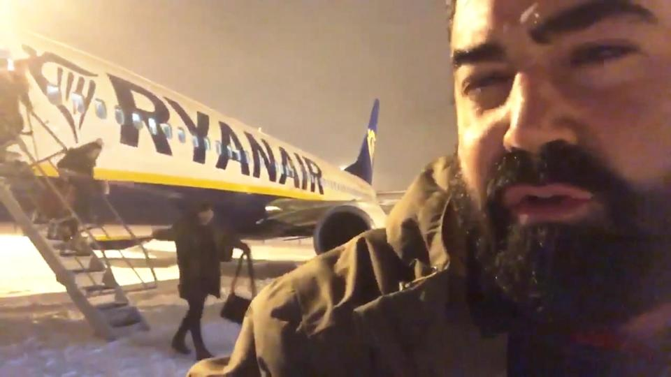 Argimiro Perez after being allowed to disembark from the snowbound flight. (Twitter)