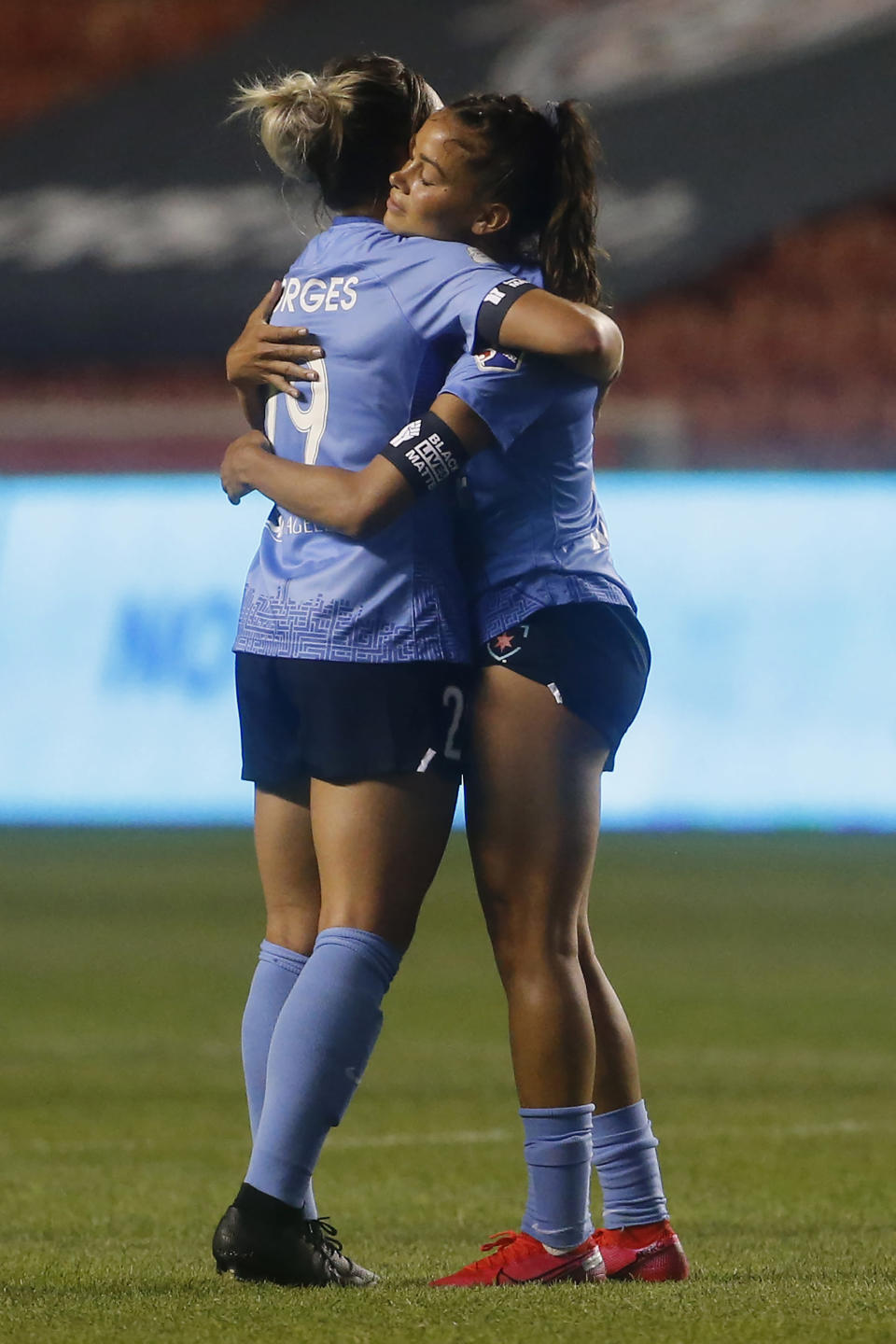 Chicago Red Stars' Bianca St. George, left, and Sarah Gorden hug after their victory over the Sky Blue during an NWSL Challenge Cup soccer semifinal match Wednesday, July 22, 2020, in Sandy, Utah. (AP Photo/Rick Bowmer)