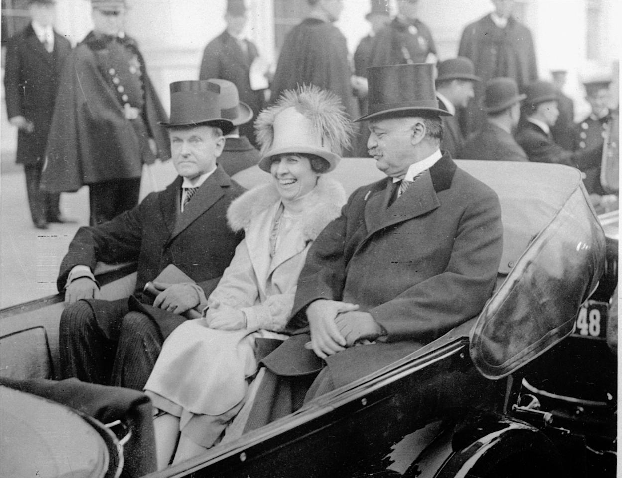 Calvin Coolidge, left, wears wing collar and muted top hat en route to take oath on inauguration day, March 4, 1925. (AP Photo)