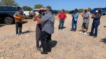 This Aug. 31, 2021 photo shows U.S. Rep. Teresa Leger Fernández dancing with state Sen. Leo Jaramillo near Abiquiu, New Mexico, as David García, left, plays a corrido, or folk song, about the traditional irrigation systems known as acequias. The systems are facing more pressure amid drought and warmer temperatures. (AP Photo/Susan Montoya Bryan)