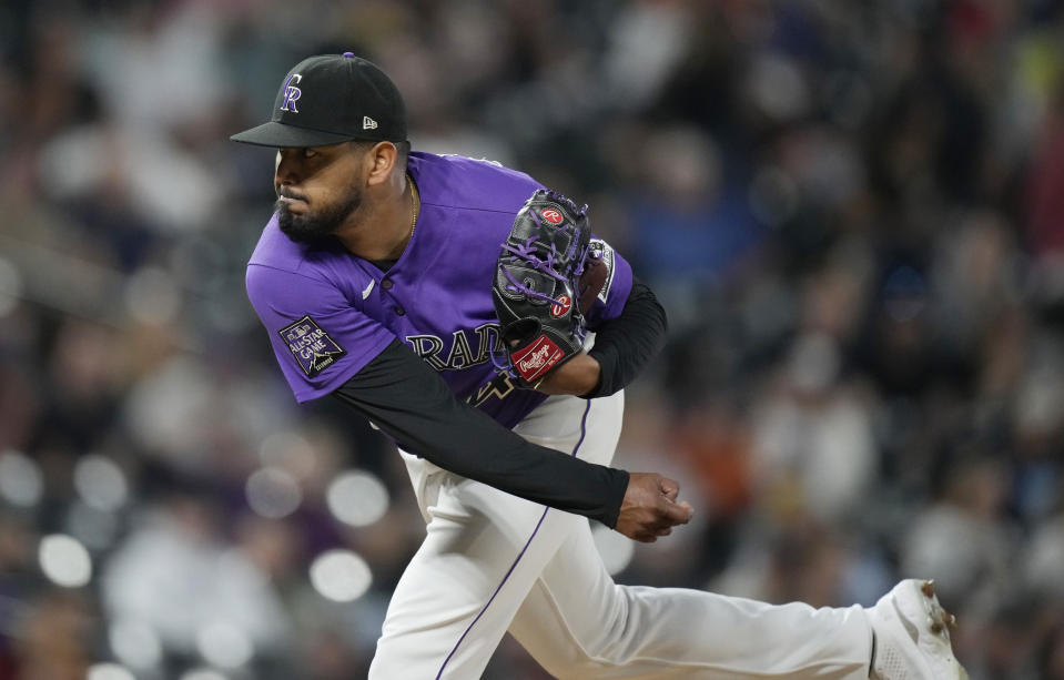 Colorado Rockies starting pitcher German Marquez works against the Arizona Diamondbacks in the seventh inning of a baseball game Friday, May 21, 2021, in Denver. (AP Photo/David Zalubowski)