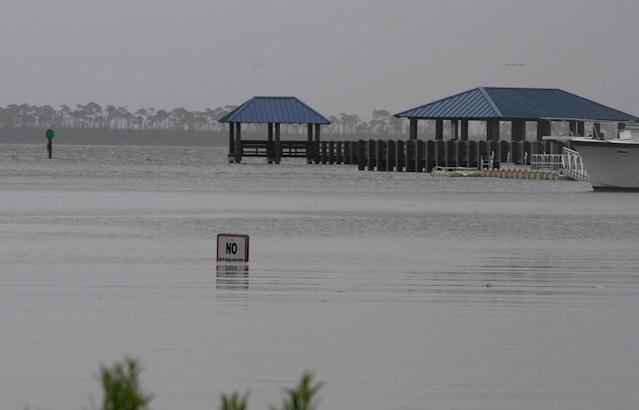 <p>The No Wake sign is almost submerged at the flooded Ocean Springs Harbor on Wednesday, June 21, 2017. Since Tuesday evening, Tropical Storm Cindy has dumped a deluge of rain on the Mississippi Gulf Coast. (Photo: Tim Isbell/Biloxi Sun Herald/TNS via Getty Images) </p>