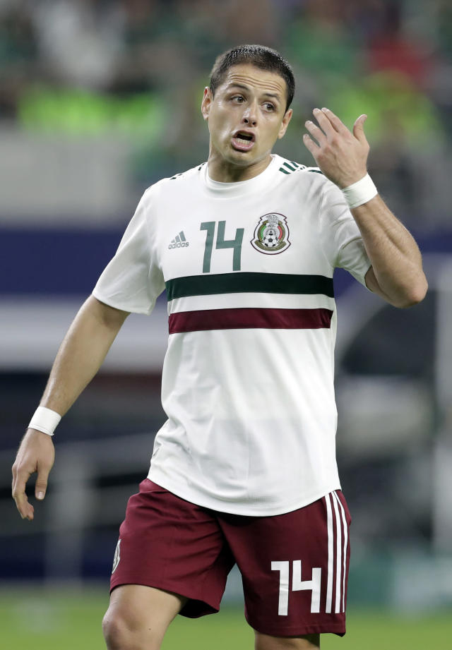 CORRECTS DATE OF PHOTO - Mexico forward Javier Hernandez (14) shouts in the direction of an official after an attack on the Croatia goal in the first half of a friendly soccer match in Arlington, Texas, Tuesday, March 27, 2018. (AP Photo/Tony Gutierrez)