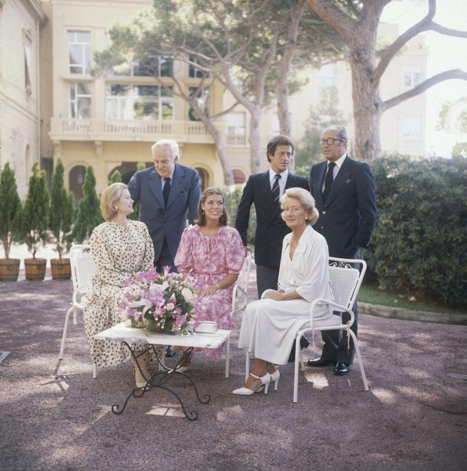 <p>Princess Caroline wore a pretty pink dress to pose for a portrait at Monaco's Royal Palace with her parents, Princess Grace and Prince Rainier, her fiancé Philippe Junot, and his parents, 1977.</p>