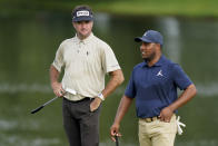 Bubba Watson, left, stands beside Harold Varner III, right, on the 13th green in the first round of play at the Northern Trust golf tournament, Thursday, Aug. 19, 2021, at Liberty National Golf Course in Jersey City, N.J. (AP Photo/John Minchillo)