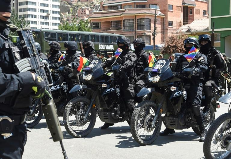 Members of the GAT anti-terrorist unit stand guard in La Paz on December 3