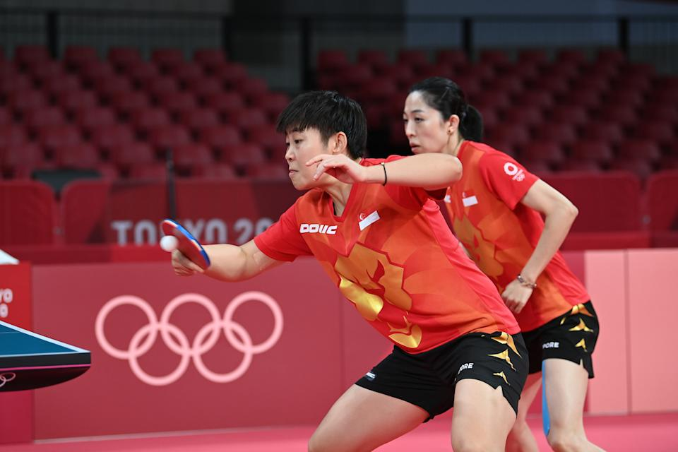 Singapore paddlers Lin Ye (front) and Yu Mengyu during the women's team round-of-16 tie against France at the 2020 Tokyo Olympics. (PHOTO: Jung Yeon-je/AFP)