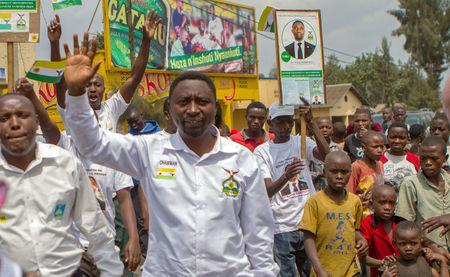 Rwanda's opposition Democratic Green Party Presidential candidate, Frank Habineza, waves to his supporters before a rally in Burera District