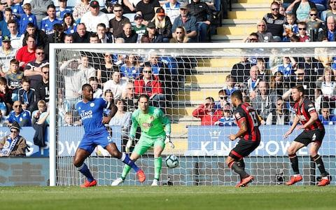 Leicester City's Wes Morgan scores their first goa - Credit: RUSSELL CHEYNE/REUTERS