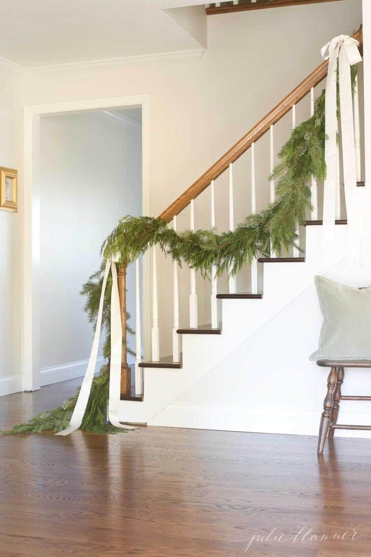 """<p>Let the beauty of live greenery shine on its own without adornments except for draping ribbon bows. Use satin ribbon for a more elegant look or substitute burlap ribbon for a more rustic appearance. </p><p><strong>See more at <a href=""""https://julieblanner.com/home-for-the-holidays/"""" rel=""""nofollow noopener"""" target=""""_blank"""" data-ylk=""""slk:Julie Blanner"""" class=""""link rapid-noclick-resp"""">Julie Blanner</a>.</strong></p><p><a class=""""link rapid-noclick-resp"""" href=""""https://www.amazon.com/Morex-Ribbon-1252-40-10-104-Natural/dp/B01MAUE8DL/ref=sr_1_8?dchild=1&keywords=cream+ribbon&qid=1633173362&sr=8-8&tag=syn-yahoo-20&ascsubtag=%5Bartid%7C2164.g.37723896%5Bsrc%7Cyahoo-us"""" rel=""""nofollow noopener"""" target=""""_blank"""" data-ylk=""""slk:SHOP RIBBON"""">SHOP RIBBON</a></p>"""
