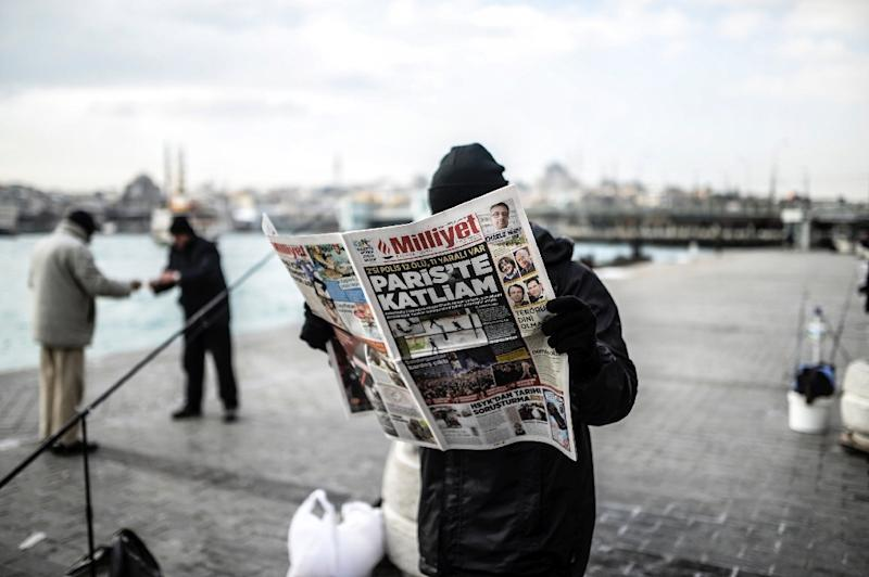 Milliyet -- long seen as a respected and mainstream title -- fired a respected columnist for criticising President Erdogan (AFP Photo/Bulent Kilic)