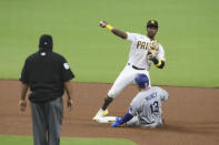 San Diego Padres second baseman Jurickson Profar, top right, attempts to turn a double play as Los Angeles Dodgers' Max Muncy, bottom right, slides into second in the fourth inning of a baseball game Monday, Sept. 14, 2020, in San Diego. Dodgers' Cody Bellinger was safe at first on the play. (AP Photo/Derrick Tuskan)