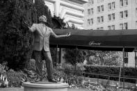 A statue of singer Tony Bennett stands outside the closed Fairmont Hotel in San Francisco on April 17, 2020. Normally, the months leading into summer bring bustling crowds to the city's famous landmarks, but this year, because of the coronavirus threat they sit empty and quiet. Some parts are like eerie ghost towns or stark scenes from a science fiction movie. (AP Photo/Eric Risberg)