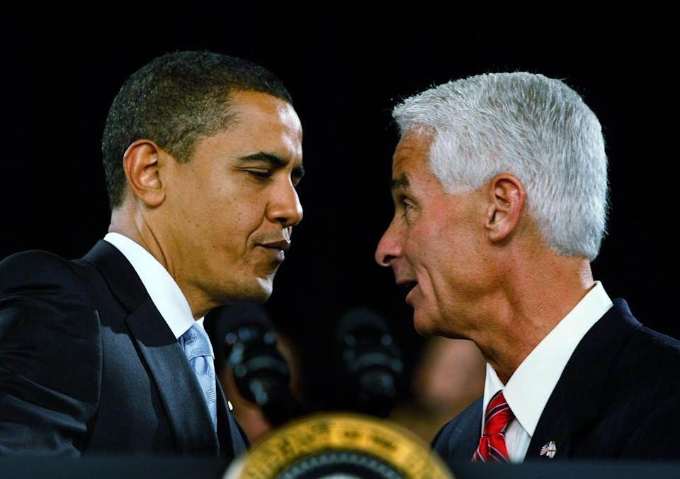 Then-Republican Gov. Charlie Crist introduces then-President Barack Obama during a town hall meeting on Feb. 10, 2009, in Fort Myers, Florida.  (Photo: Joe Raedle via Getty Images)