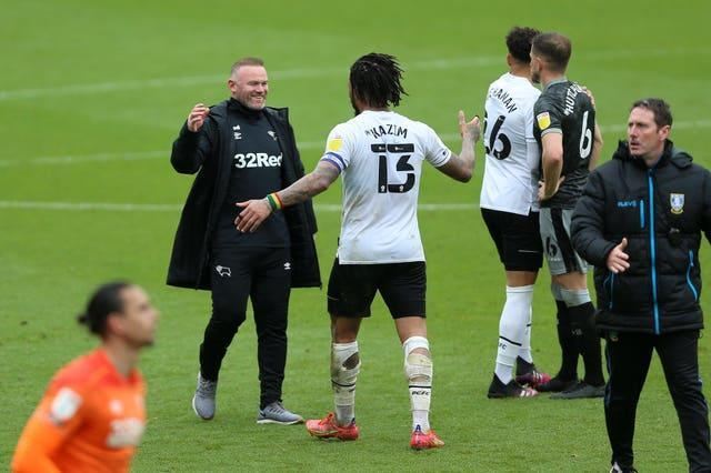 Derby manager Wayne Rooney (left) celebrates the club's Sky Bet Championship survival with Colin Kazim-Richards (13) after a final-day draw with Sheffield Wednesday