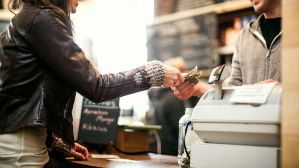 PHOTO: A woman pays for an item in this stock photo. (STOCK PHOTO/Getty Images)