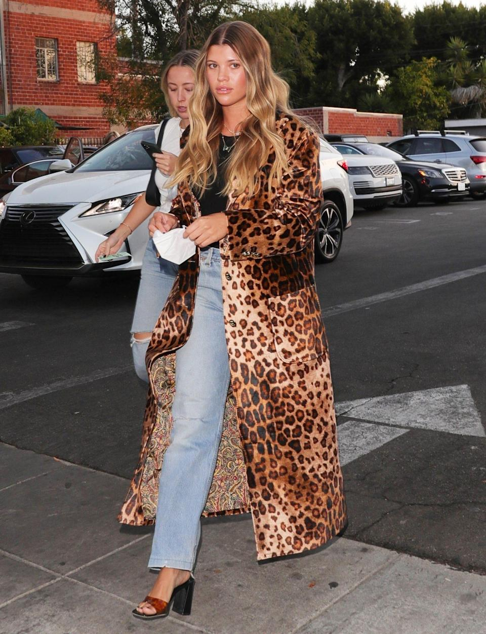 <p>Sofia Richie arrives at dinner at Matsuhisa in Beverly Hills in a leopard print coat on June 10. </p>