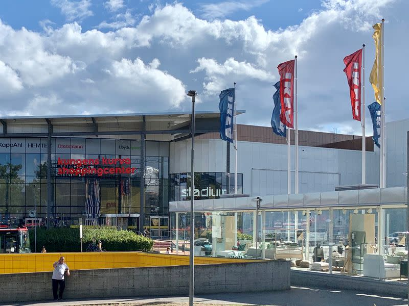 FILE PHOTO: Furniture brand IKEA flags are seen next to a shopping mall owned by IKEA's malls arm Ingka Centres, on the outskirts of Stockholm