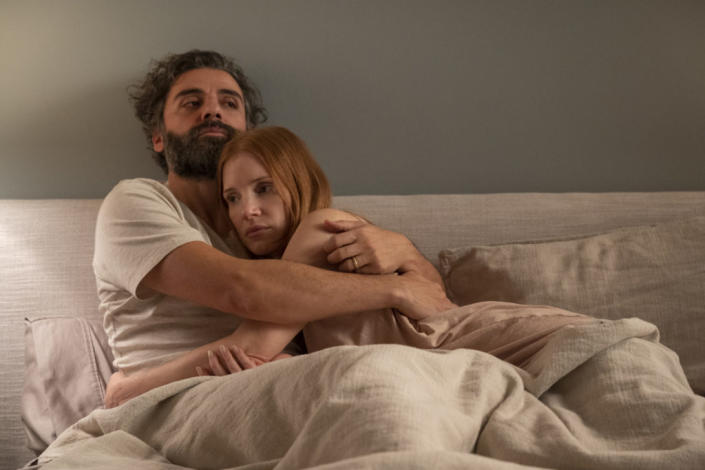Jessica Chastain and Oscar Isaac kiss in a scene from Scenes from a Marriage.  Image via Crave