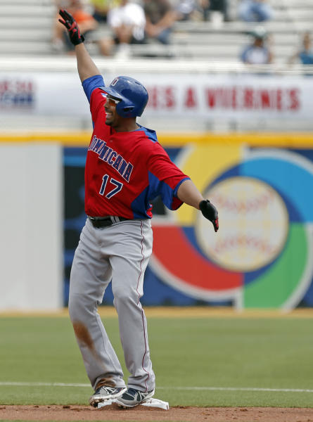 Dominican Republic's Nelson Cruz celebrates after hitting an RBI single off Spain starting pitcher Yoanner Negrin in the second inning of a World Baseball Classic game in San Juan, Puerto Rico, Saturday, March 9, 2013. (AP Photo/Andres Leighton)