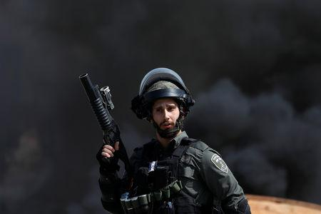 An Israeli border police gestures during clashes with Palestinian protesters near the Jewish settlement of Beit El, in the Israeli-occupied West Bank March 20, 2019. REUTERS/Mohamad Torokman