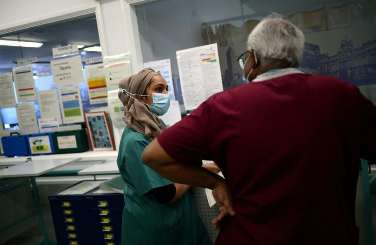 Britain's state-run National Health Service is facing a staffing crisis, as coronavirus pressures combine with post-Brexit immigration policies and retirement of foreign doctors (AFP/HANNAH MCKAY)
