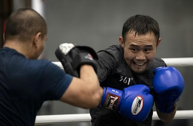 "Zhang Fangyong ""hits the mitts"" during training at his Beijing gym (AFP Photo/NOEL CELIS)"