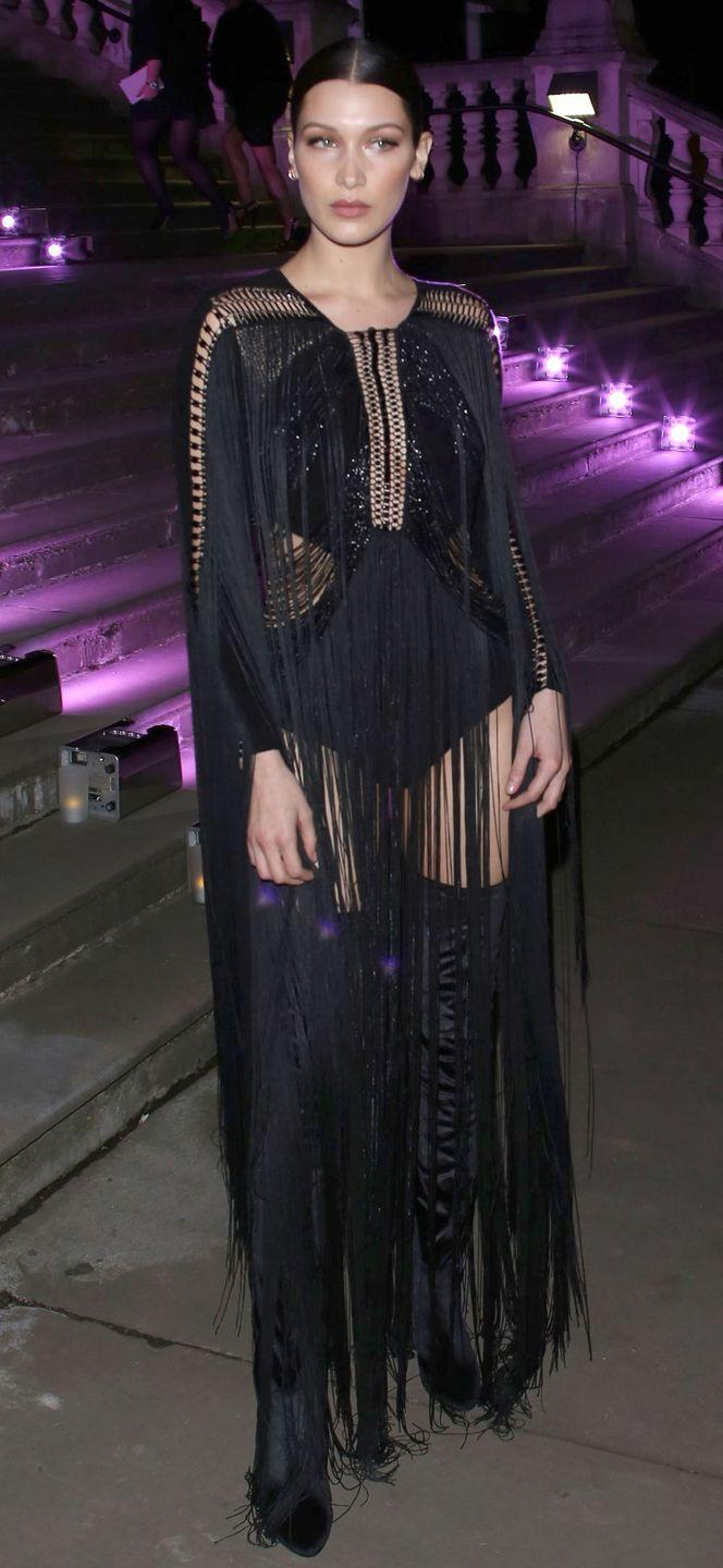 <p>In a fringed black Julien MacDonald gown at the Elle Style awards, London Fashion Week.</p>