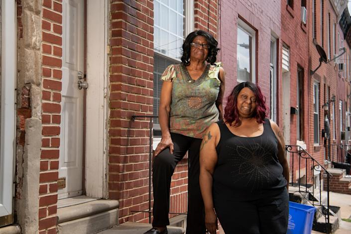 Monique Sharp, left, says she suspects lenders targeted the neighborhood where her mother, Phyllis, lives because home values were rising.
