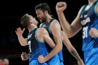 Slovenia's Mike Tobey (10) celebrates his score against Spain with teammate Klemen Prepelic (7) during a men's basketball preliminary round game at the 2020 Summer Olympics, Sunday, Aug. 1, 2021, in Saitama, Japan. (AP Photo/Eric Gay)