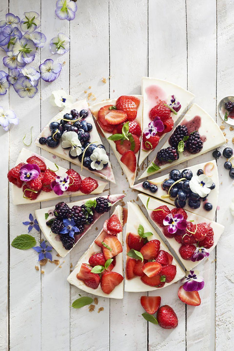 "<p><span class=""redactor-unlink"">A classic cheesecake is good, but a cheesecake topped with strawberries, blueberries, and raspberries is better. This cake makes for an stunning centerpiece <em>and</em> Mom will also get to choose her favorite fruit flavor.</span></p><p><strong><a href=""https://www.countryliving.com/food-drinks/recipes/a41977/no-bake-cheesecake-recipe/"" rel=""nofollow noopener"" target=""_blank"" data-ylk=""slk:Get the recipe"" class=""link rapid-noclick-resp"">Get the recipe</a>.</strong></p><p><a class=""link rapid-noclick-resp"" href=""https://go.redirectingat.com?id=74968X1596630&url=https%3A%2F%2Fwww.etsy.com%2Flisting%2F619363482%2Fedible-flowers-pansy-mix&sref=https%3A%2F%2Fwww.countryliving.com%2Ffood-drinks%2Fg3185%2Fmothers-day-cakes%2F"" rel=""nofollow noopener"" target=""_blank"" data-ylk=""slk:SHOP EDIBLE FLOWERS"">SHOP EDIBLE FLOWERS</a><br></p>"